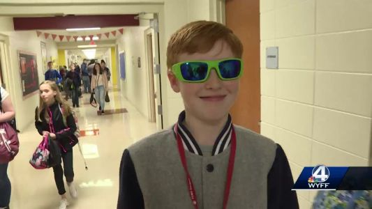 Students welcome back classmate with eye cancer, all sporting shades