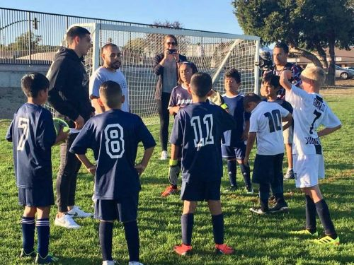 San Jose Earthquakes player Cristian Espinoza trains a local youth soccer team from Watsonville