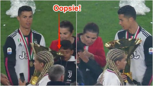 Cristiano Ronaldo accidentally hit his 8-year-old son on the head with a massive trophy, then almost did the same thing to his girlfriend