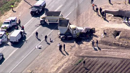 Police: 13 killed when semitruck hits SUV carrying 25 people
