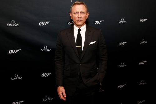 Daniel Craig surrounded by security at Omega Bond Watch reveal