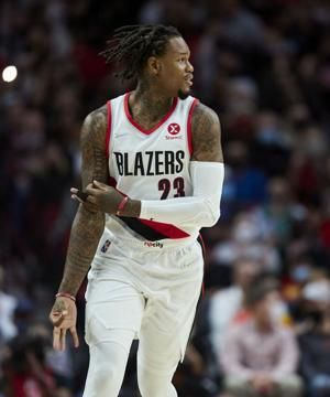 McCollum helps Blazers rout Suns for first win of season