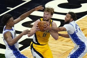 Holiday, Sabonis lead Pacers past Magic, 111-106