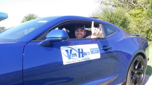 Cancer survivor sinks hole-in-one at charity outing, wins new car