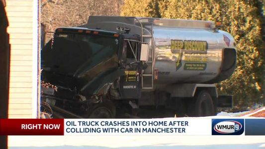 Oil truck crashes into home after crash with car in Manchester
