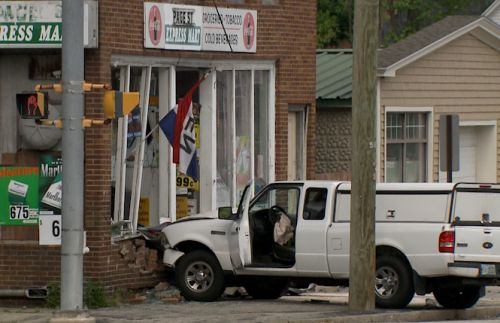 One person dies after vehicle crashes into Manchester building