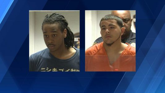 Two men accused of leading police on chase in stolen SUV arraigned