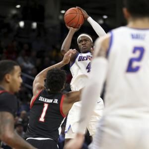 DePaul tops Texas Tech 65-60 in OT behind Coleman-Lands