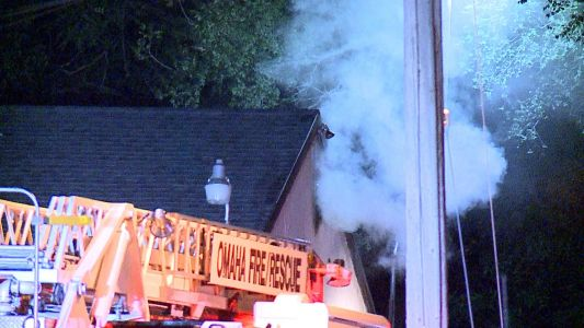 Firefighters douse flames on balcony, in garages