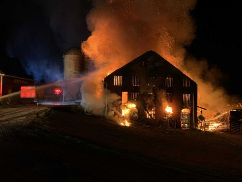 Two barns in same area go up in flames