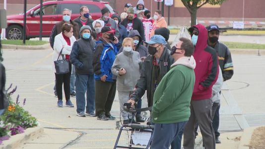 Battleground county in a battleground state: Kenosha voters lineup for early voting