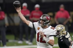 Brady, Bucs, end playoffs for Saints, Brees, 30-20