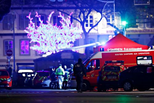 France hunts for suspected extremist who attacked Christmas market