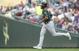 Semien 3 extra-base hits, surging A's beat Twins 5-3