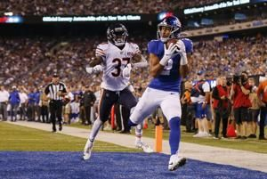 Manning, Jones lead Giants over Bears 32-13