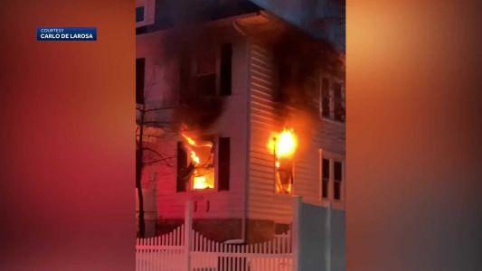 Father killed in Lawrence apartment fire