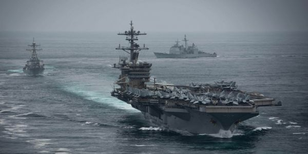 A USS Theodore Roosevelt sailor with coronavirus was taken to the ICU, as cases on the aircraft carrier continue to rise