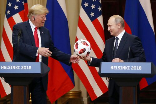 Putin gifts Trump with symbolic World Cup soccer ball