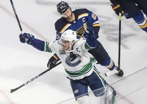Canucks beat Blues 4-3 in OT to take 2-0 series lead