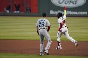 Ozuna, Braves beat Miami, clinch 3rd straight NL East title
