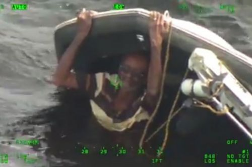 Man rescued after clinging to capsized boat for nearly 20 hours