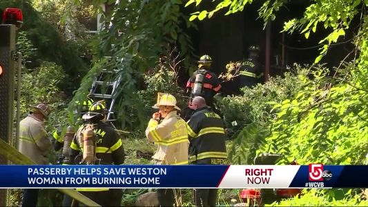 Woman rescued from burning home