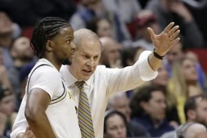 Matthews' double-double leads Michigan past Grizzlies, 74-55