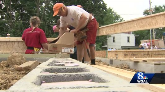 Teens build homes for families in need
