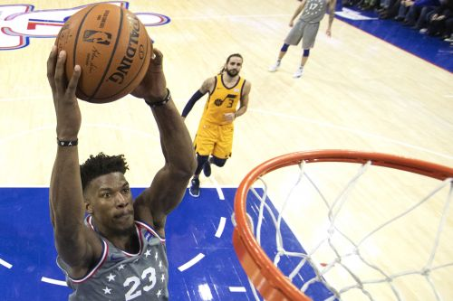 Butler serenaded by 76ers fans in smashing home debut