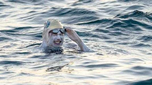 American cancer survivor swims the English channel four times non-stop