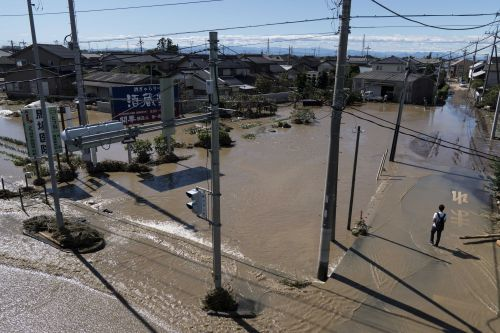 Report: Typhoon leaves up to 33 dead in Japan as rescues continue