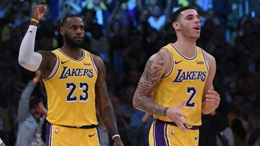 Lakers' LeBron James, Lonzo Ball revel in triple-double feat
