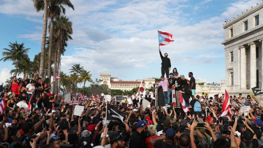 Puerto Rican Police Fire Tear Gas At Huge Protests Over Governor's Texts