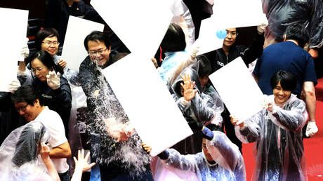 Taiwanese MPs throw PUNCHES and WATER BALLOONS amid anger over watchdog head nomination
