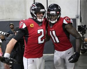 Ryan overcomes 3 interceptions to lead Falcons to first win