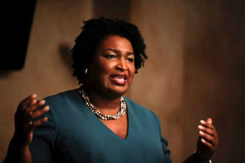 Vice presidential contender Stacey Abrams says Trump is trying to 'steal the vote' by undermining the US Postal Service