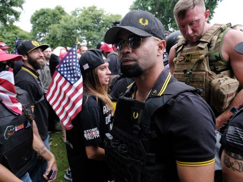 Fashion brand Fred Perry halted sales of a polo shirt adopted by the far-right Proud Boys group