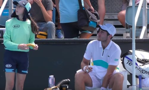 A 21-year-old tennis player was told off by an umpire at the Australian Open after he asked a ball girl to peel his banana for him