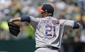 Greinke earns 200th win as Astros beat A's 4-1 to stop slide