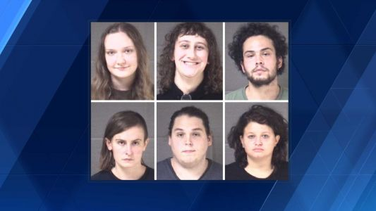 Six people arrested after officers were assaulted during protest, police say