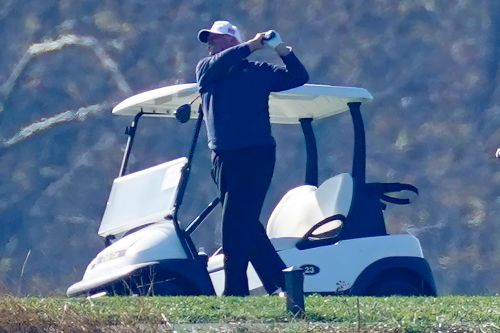 President Trump returns to golf outing for second straight day
