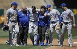 Blue Jays lose Shoemaker to knee injury, beat Athletics 10-1