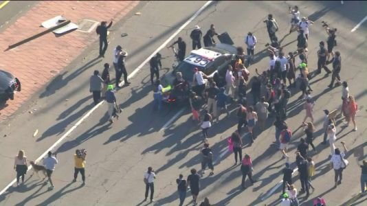 Black Lives Matter protestors march through downtown L.A., block 101 Fwy