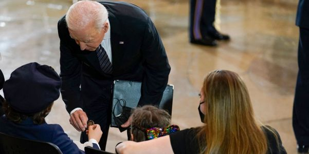 Biden picks up a toy and consoles the family of fallen Capitol Police officer Billy Evans