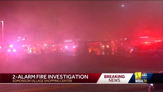 Crews fight fire at Edmondson Village Shopping Center