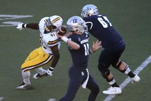 Strong gets Nevada past Wyoming 37-34 in OT to open season