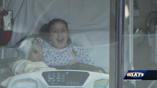 Ahead of young girl's 48th surgery, friends surprise her outside hospital window