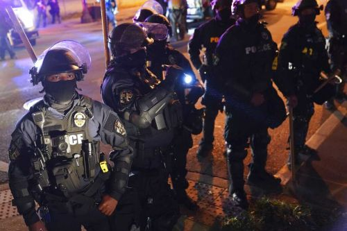 Police declare unlawful assembly in Louisville, Kentucky, after windows shattered
