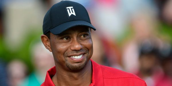 Tiger Woods says he was trying to hold back tears and play like 'every weekend hacker' on the final hole of his first tournament win in 5 years