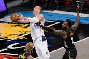 Mavs end Nets' 8-game run as Porzingis returns, Irving sits
